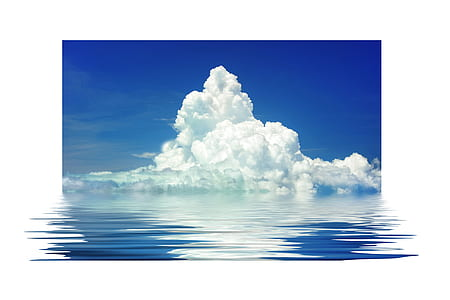 body of water and white clouds over the horizon