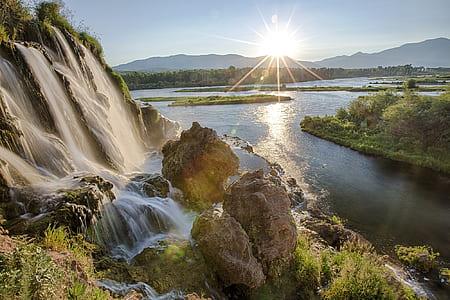 waterfalls near a lake