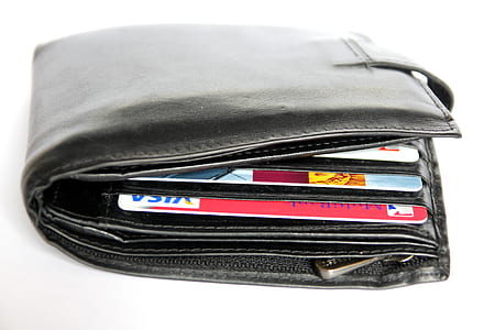 black leather wallets and assorted cards