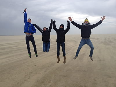 five men jumped on desert