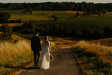 couple walking on a concrete road photo