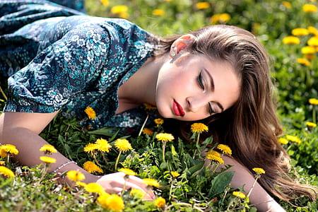 woman lying on daisy flowers