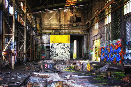 empty warehouse filled with graffiti