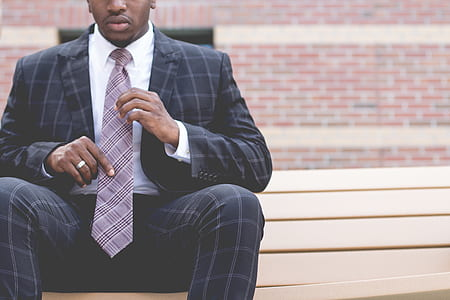 man in black and gray plaid suit set