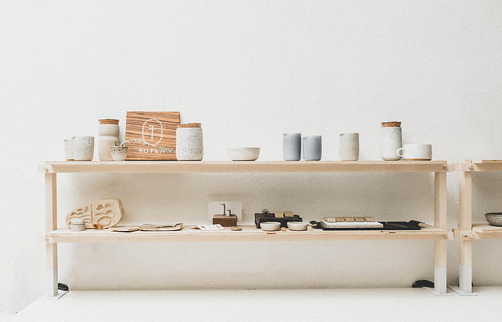 white wooden console table with jars on top