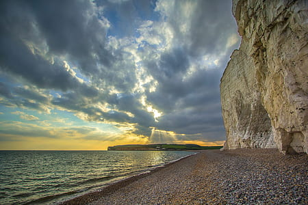 Beige and Grey Rock on the Seashore Photograph