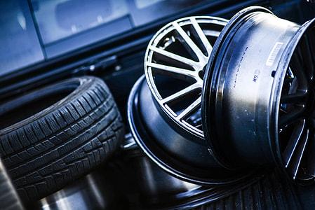 two silver multi-spoke vehicle wheel near vehicle tire