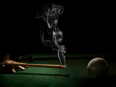 time lapse photography of burning cue stick near white ball
