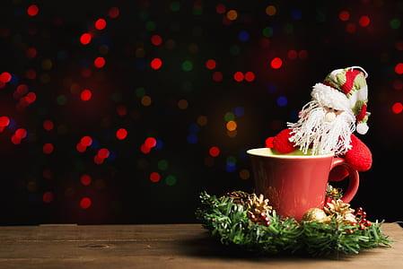 Santa Claus figurine in red ceramic cup