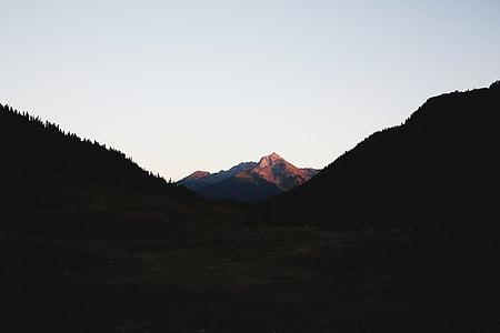 in distant photo of mountain peak