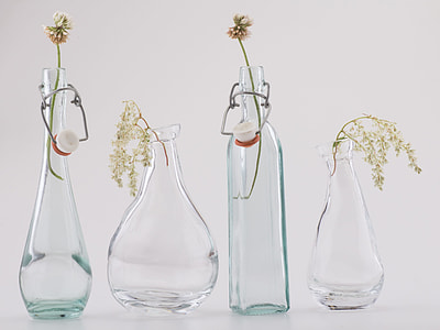 close-up photo of four clear glass vases