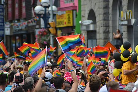 people racing the flag of LGBT