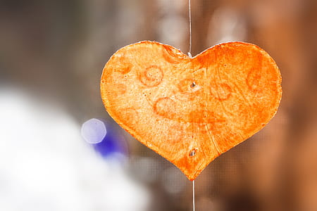 selective focus photography of decorative yellow and orange heart