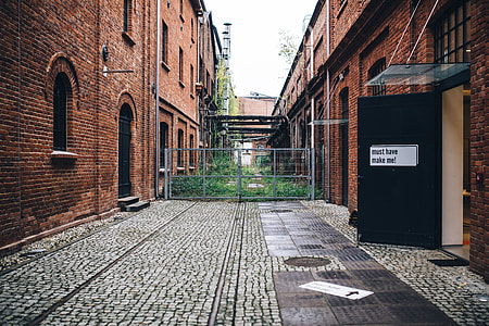 By the entrance to the gallery in the abandoned factory