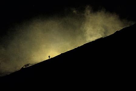 person walking towards mountain