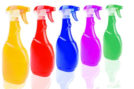 five assorted-color spray bottles