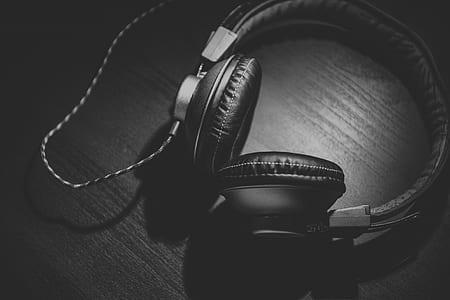 black corded headphones grayscale photo
