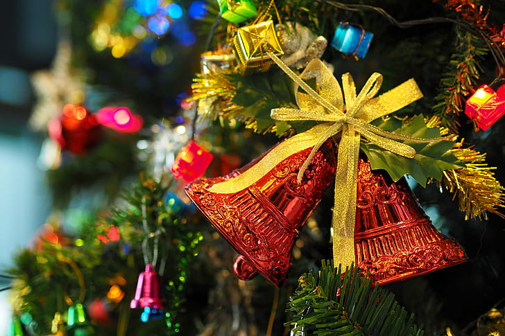 close-up photography of Christmas three bell ornament