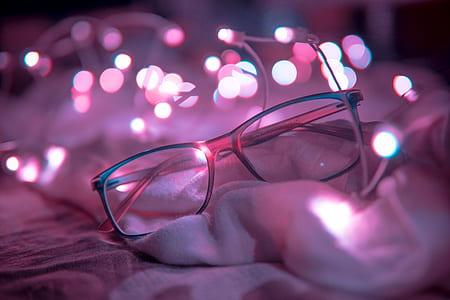 Shallow Focus Photography of Blue-framed Eyeglasses Near String Lights