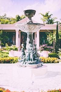 brown outdoor fountain near garden