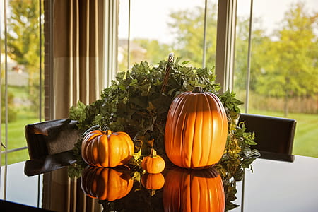 pumpkins on top of glass table