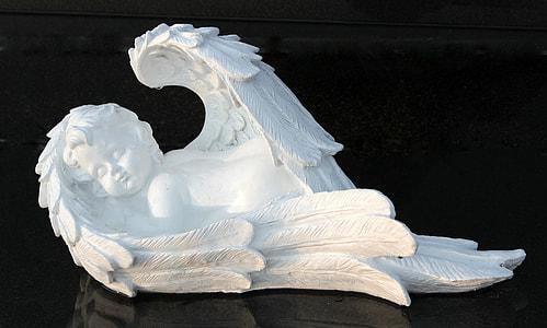 white cherub figurine