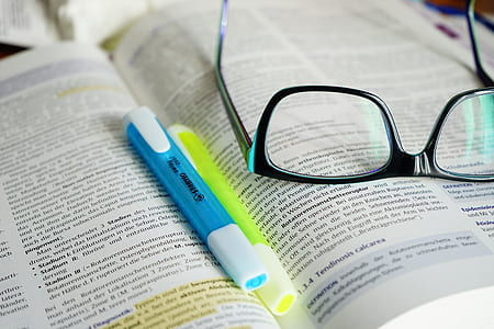 eyeglasses on book page