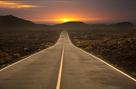 asphalt road during sunset