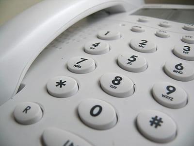 closeup photo of white telephone