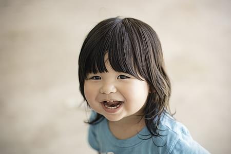 smiling girl wearing blue shirt
