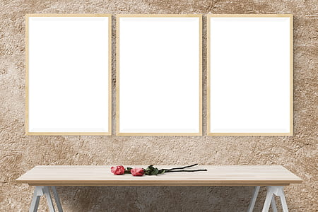 two red roses on rectangular brown wooden trestle table