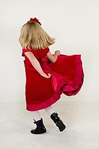 girl wearing red velvet short-sleeved dress