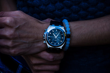 Closeup shot of a man wearing a wrist watch