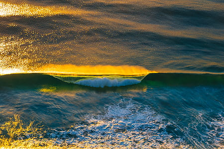blue body of water waving
