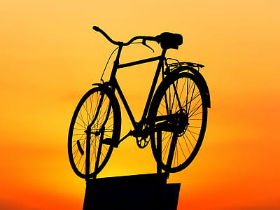 silhouette photography of bicycle during sunset
