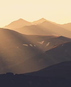 brown mountains under golden hour