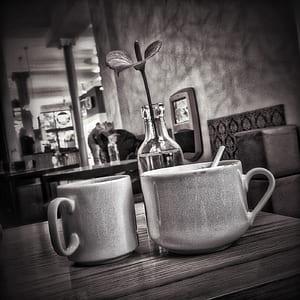 grayscale photo of two ceramic mugs