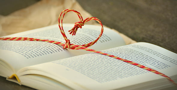book with heart strings