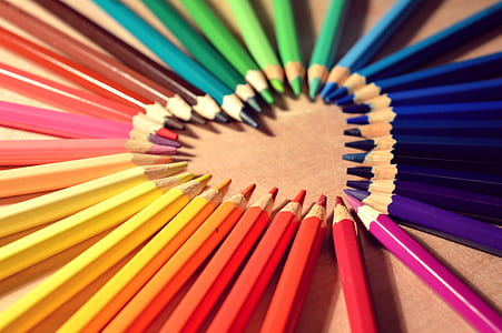 multicolored color pen in heart formation