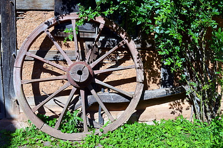 brown wooden carriage wheel