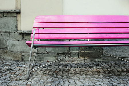 Wide angle shot of a vibrantly coloured pink bench in an urban setting, image captured with a Canon DSLR