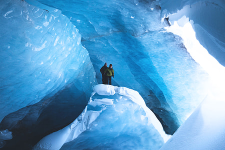 Two people exploring the snow and ice in Canada