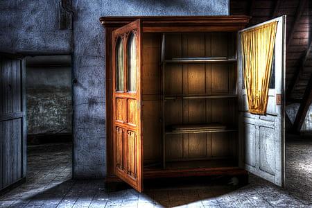 photograph of opened cabinet between doorway
