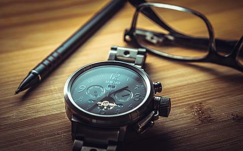 silver analog watch at 1:35
