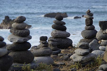 cairne rock near body of water