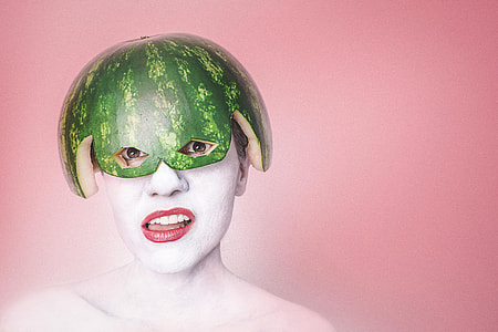 woman with watermelon on head