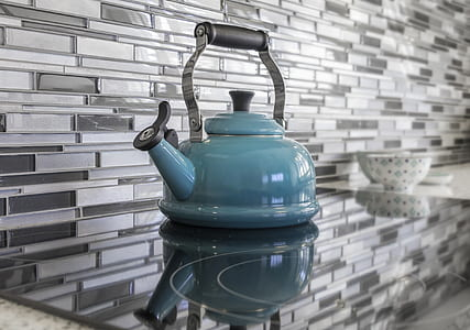 blue kettle on induction cooker