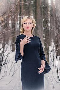 woman wearing black long-sleeved dress during daytime