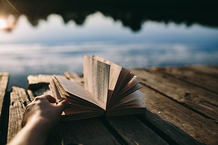 Reading book at lake