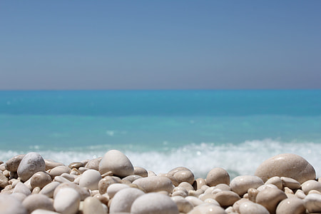 white stones on sea shore during daytime